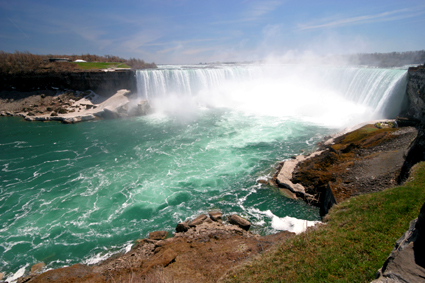 Niagara Falls forms the Canadian-US border (75 miles SE of Toronto)